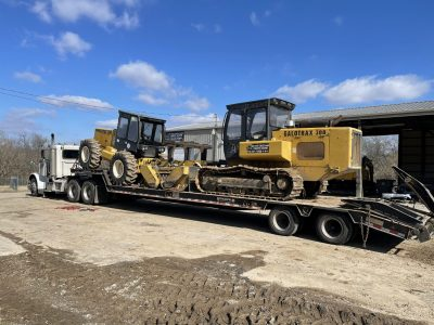 image of two mulchers on a truck for Midstate Land Clearing and Forestry Mulching LLC